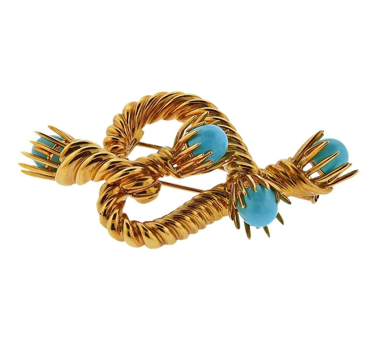 18k gold brooch , crafted by Jean Schlumberger for Tiffany & Co, adorned with turquoise.  Brooch is 60mm x 35mm. Weight is 28 grams. Marked Tiffany & Co, Schlumberger Studios, 750.