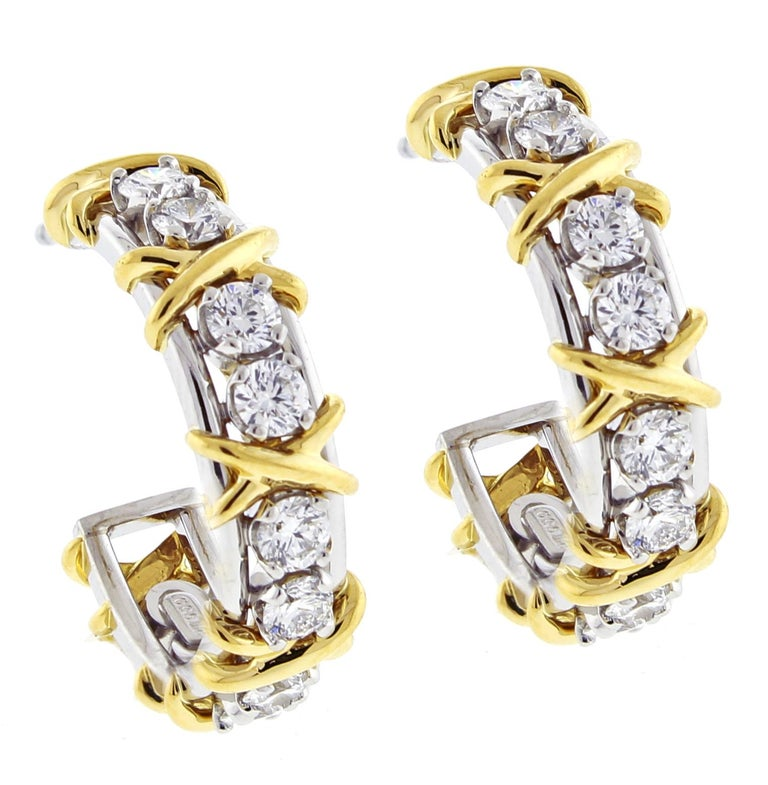 Jean Schlumberger's visionary creations are among the world's most intricate designs. Blazing diamonds topped by golden X's create these glamorous earrings.  ♦ Designer:  Schlumberger ♦ Retail $16,000 ♦ Metal: 18 karat and platinum ♦ 20 diamonds =