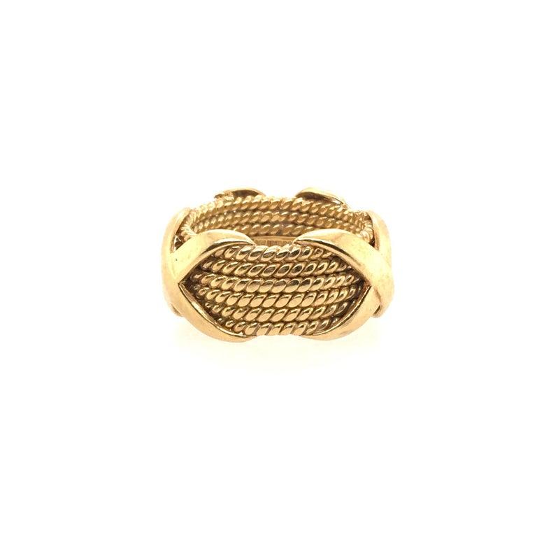 An 18 karat yellow gold Rope Six-row X Ring. Schlumberger, Tiffany & Co,. Size 5, gross weight 10.8 grams.