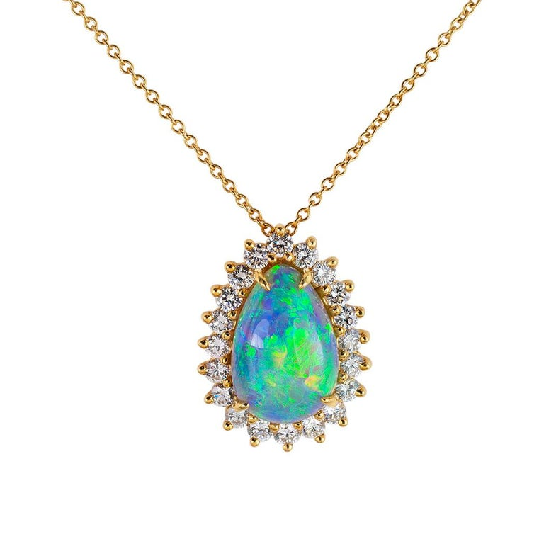 Tiffany & Co semi-black boulder opal diamond and yellow gold pendant circa 1980.  Clear and concise information you want to know is listed below.  Contact us right away if you have additional questions.  We are here to connect you with beautiful and