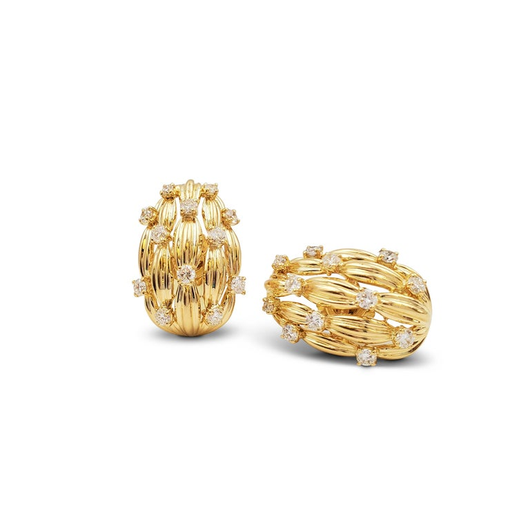 Authentic classic pair of 18 karat yellow gold and diamond earrings from the