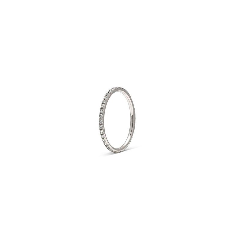 Authentic Tiffany & Co. 'Soleste' eternity band crafted in 18 karat white gold and set with approximately 0.42 carats of glittering round brilliant cut diamonds. US Size 5. Signed Tiffany & Co., 750, Belgium. Ring is presented without the original
