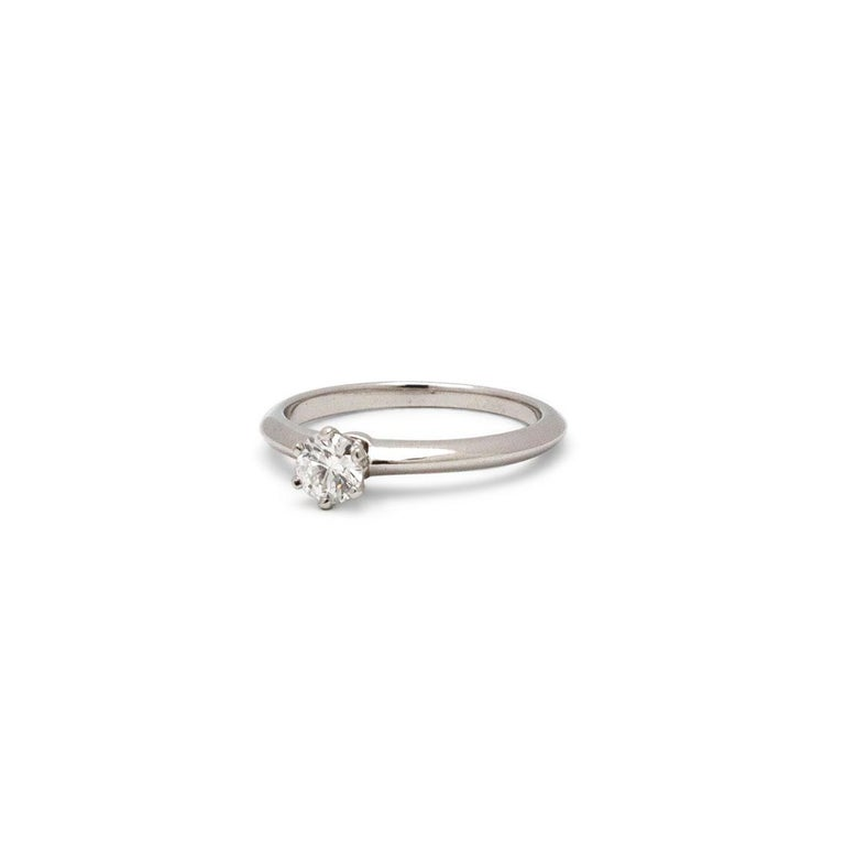 Authentic Tiffany & Co. engagement ring made in platinum set with a 0.32 carat round brilliant cut diamond, G color, VS1 clarity. Cut is graded Excellent and polish is graded as Very Good. The symmetry is graded as Very Good and there is no