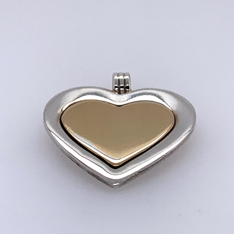 Women's or Men's Tiffany & Co. Sterling and Gold Heart Pendant For Sale