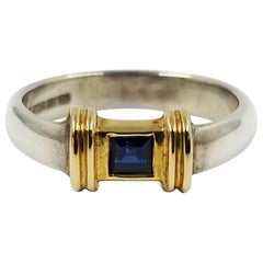 Tiffany & Co. Sterling Silver and 18 Karat Yellow Gold Sapphire Solitaire Band