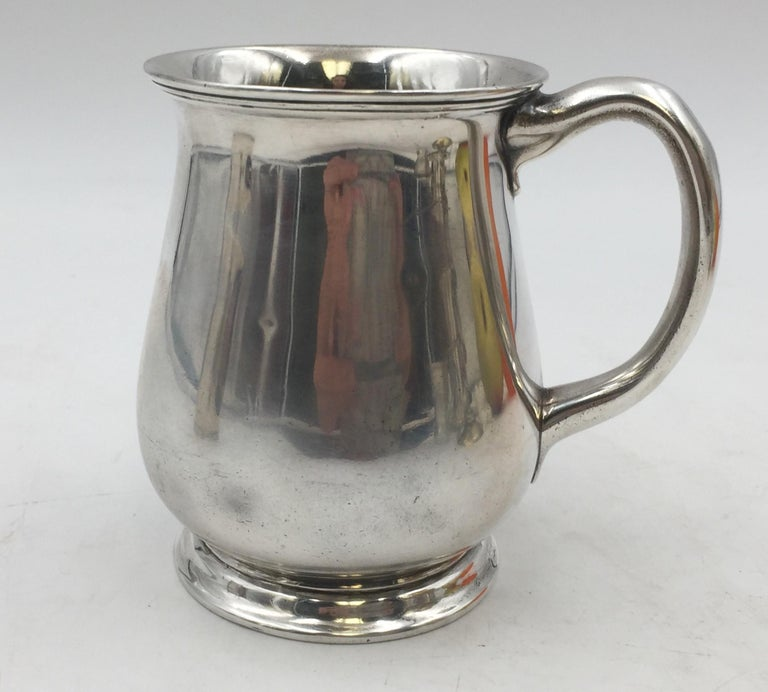 Tiffany & Co. sterling silver christening cup / child mug in pattern 16088 from 1904 in simple, elegant design, measuring 3 7/8'' in height and 3 3/4'' from handle to cup, weighing 5.7 ozt, and bearing hallmarks as shown.  Founded in 1837 by