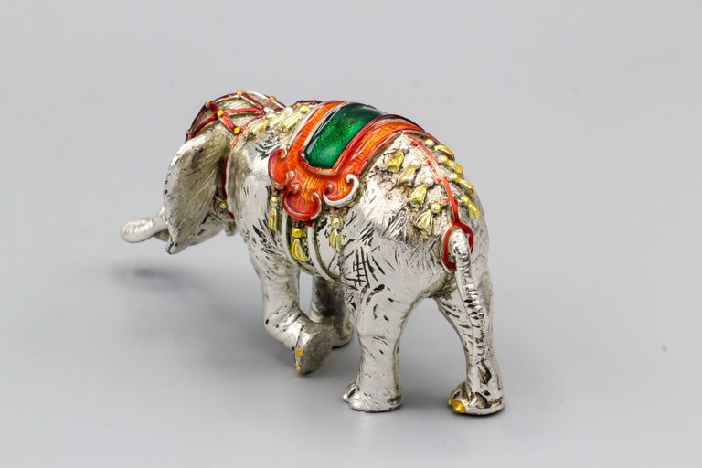 Rare and unusual sterling silver and multi colored enamel circus figurine by Tiffany & Co., circa 1990s.  Hallmarks: Tiffany & Co., Sterling, 925, Made in Italy.