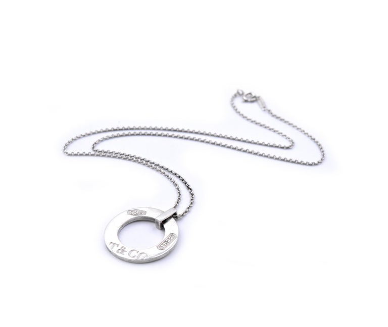 Designer: Tiffany & Co. Material: sterling silver Dimensions: necklace is 16 inches long and pendant measures 24mm in diameter Weight: 7.38 grams