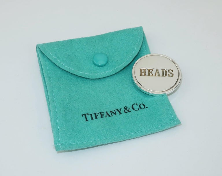 Either way you call it, this Tiffany & Co. sterling silver coin will always be a winner.  Cleverly embossed with 'Heads' on one side and 'Tails' on the other.  Measures 1.13