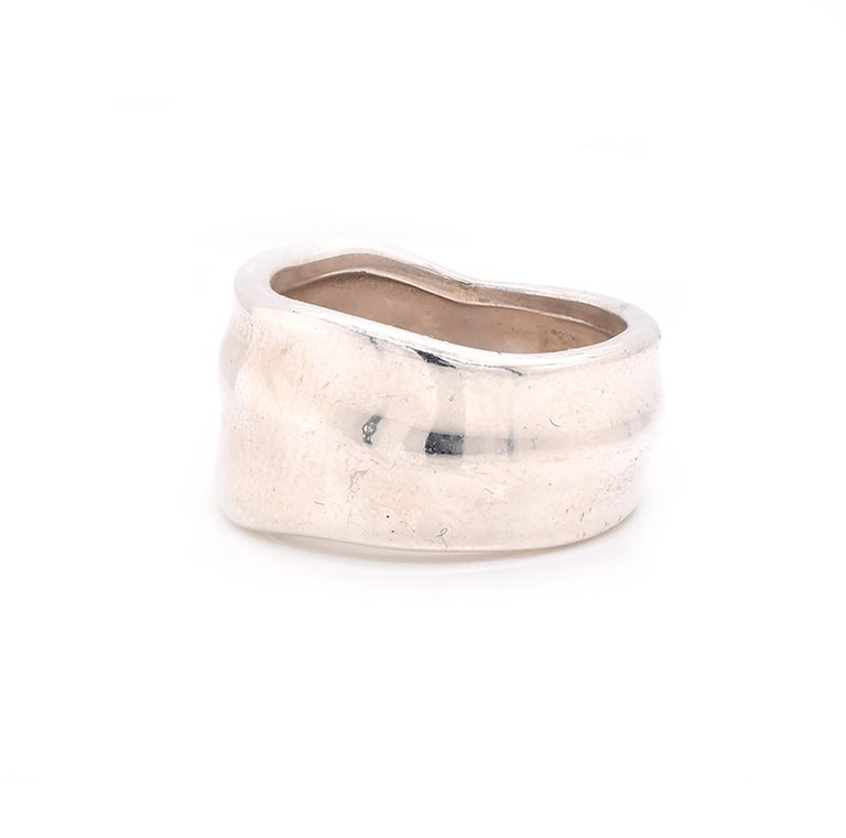 Designer: Tiffany & Co. Material: Sterling silver  Measurement: Band measures 10.7mm wide Size: 4.5 (please allow two additional days for complimentary sizing)  Weight: 6.84 grams