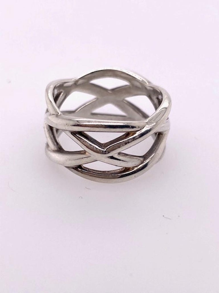 Wide open lattice-work ring.  Made and signed by TIFFANY & CO.  Sterling silver.  Size 7 1/2.