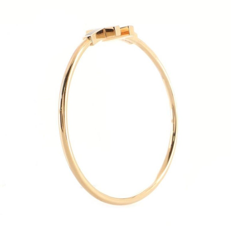 Tiffany & Co. T Wire Bracelet 18K Rose Gold with Diamonds and Mother of Pearl In Good Condition For Sale In New York, NY