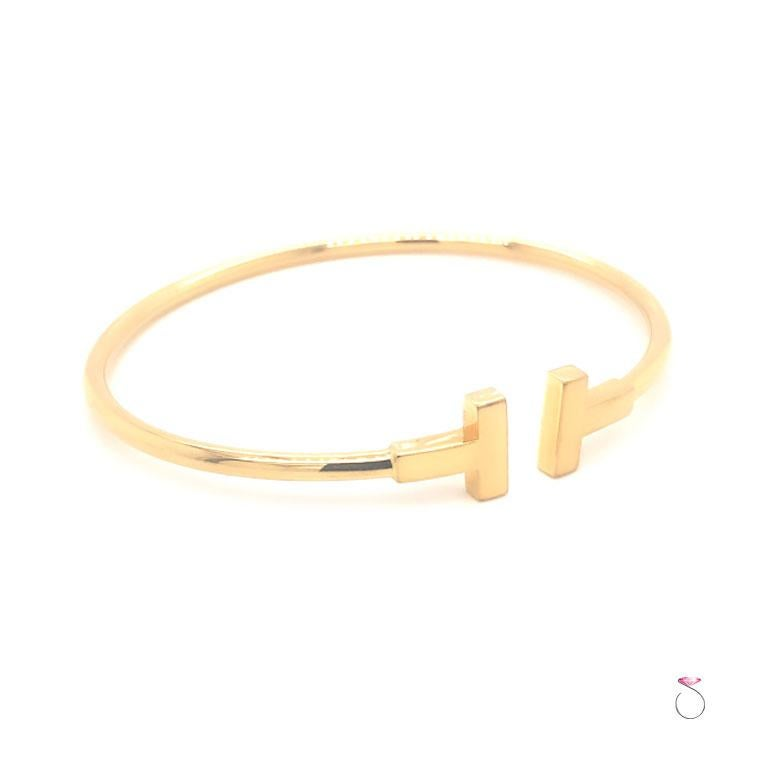 Authentic Tiffany & Co. T wire bracelet in 18K yellow gold. This bracelet's