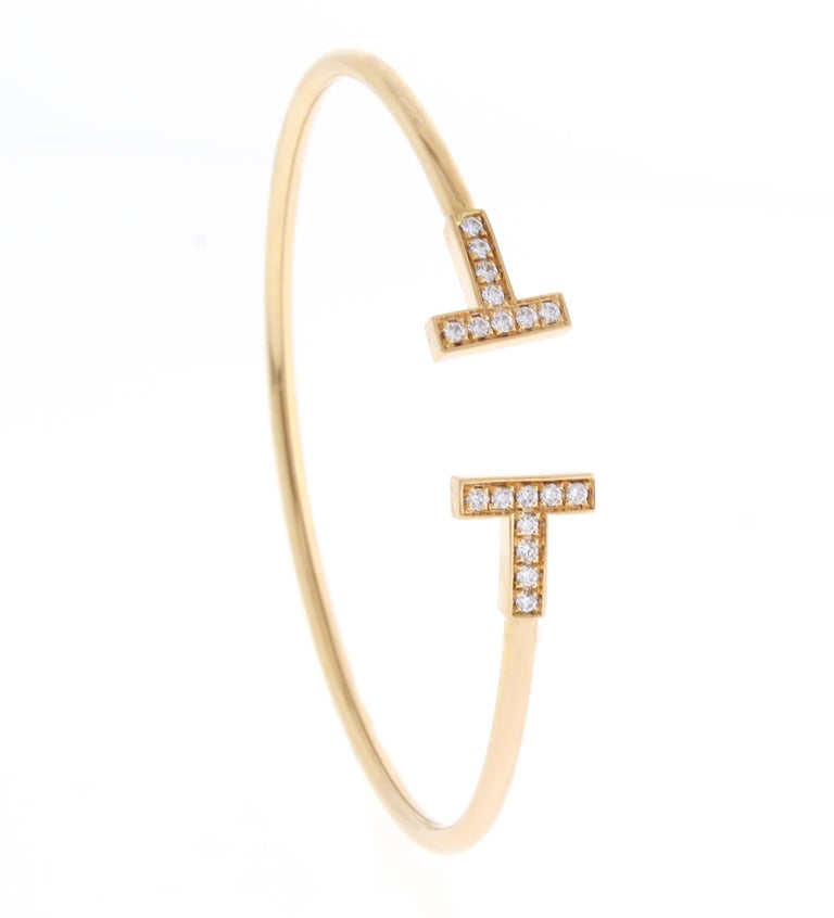 Graphic angles and clean lines blend to create the beautiful clarity of the Tiffany T collection. Brilliant diamonds enhance this bracelet's timeless elegance.  18 karat  pink gold with round brilliant diamonds Size medium Fits wrists up to