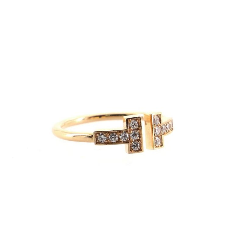 Condition: Great. Minor wear throughtout. Accessories: No Accessories Measurements: Size: 5, Width: 1.45 mm Designer: Tiffany & Co. Model: T Wire Ring 18K Rose Gold with Diamonds Exterior Material: Diamond, 18K Rose Gold Exterior Color: Rose