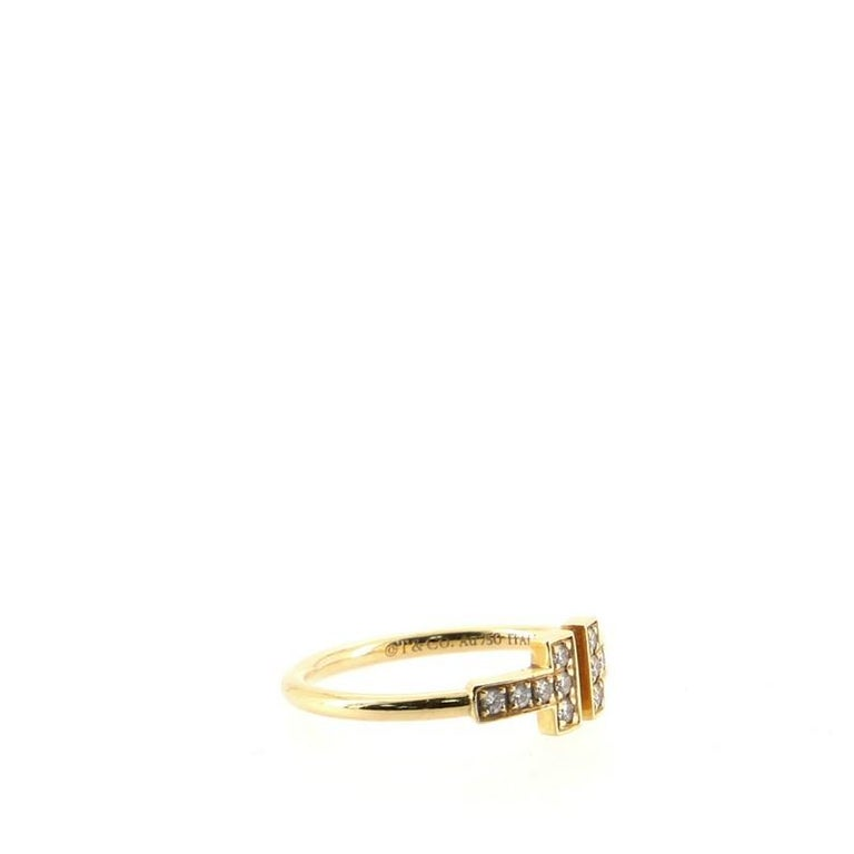 Condition: Great. Shows signs of faint wear. Accessories: No Accessories Measurements: Size: 5.5 Designer: Tiffany & Co. Model: T Wire Ring 18K Yellow Gold with Diamonds Exterior Material: 18K Yellow Gold, Diamond Exterior Color: Yellow Gold Item