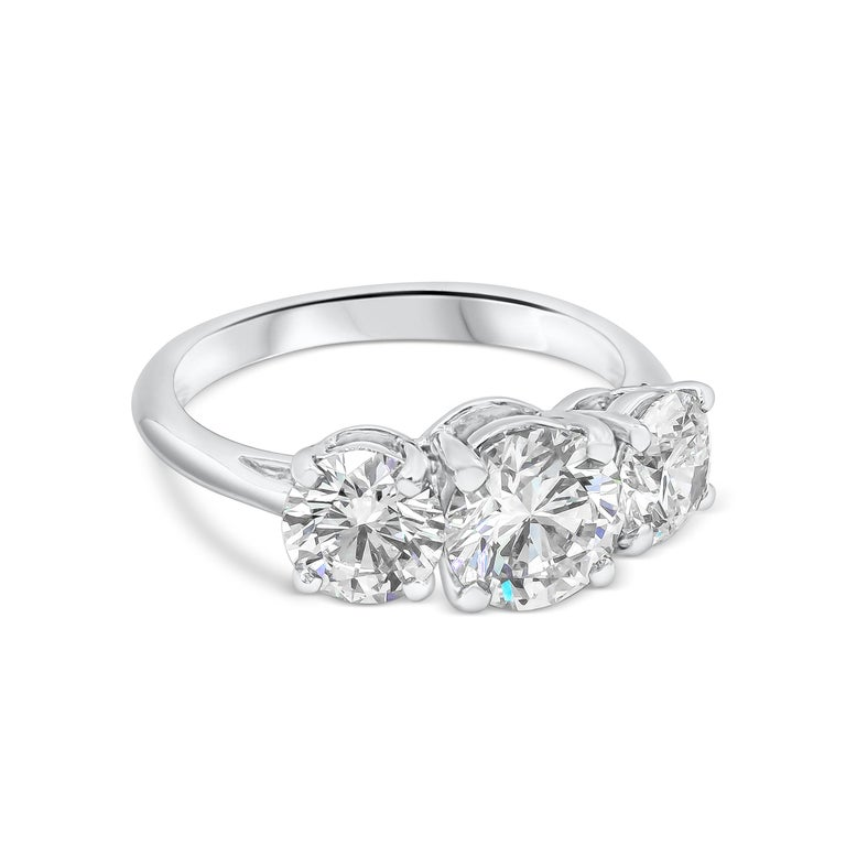 Classic three-stone engagement ring by Tiffany & Co. The center diamond is 1.22ct H, VS1. Flanked on either side by round diamonds 0.71ct H, VS1 and 0.71ct J, VVS2. All three diamonds are certified by GIA. The ring set in Platinum 950. Signed and