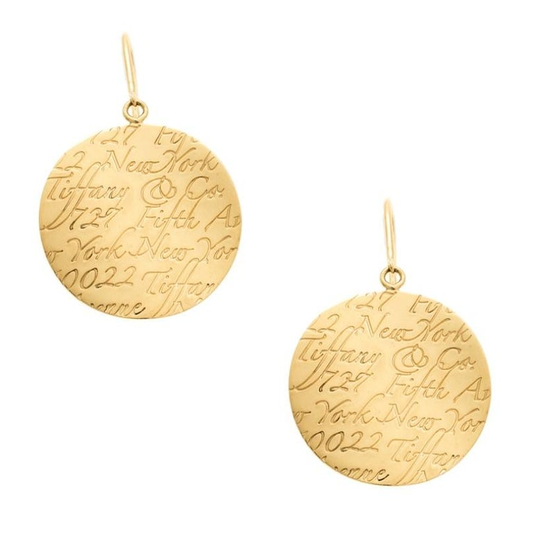 Contemporary Tiffany & Co. Tiffany Notes Engraved 18k Yellow Gold Round Hook Earrings For Sale