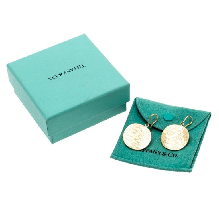 Women's Tiffany & Co. Tiffany Notes Engraved 18k Yellow Gold Round Hook Earrings For Sale