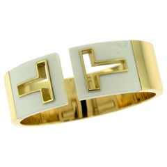 Tiffany & Co. Tiffany T Cut-Out Yellow Gold White Enamel Flexible Bracelet Cuff