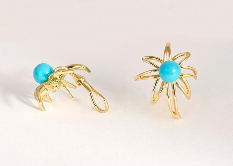 A Tiffany & Co. classic. The fireworks collection is rarely offered with turquoise. Approximately 1 inch in size.