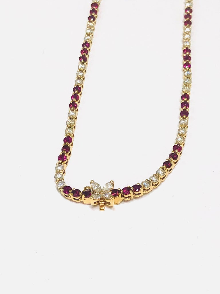 Tiffany & Co. graduated Ruby and Line Diamond necklace crafted in 18k Yellow Gold from the Victoria Collection. There is approximately 6.75 carat of Round Faceted Rubies and approximately 5.7 carat of Round Brilliant and Marquise cut diamonds. Comes