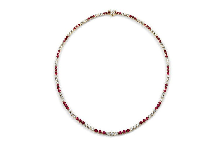 Estate Tiffany Victoria Collection Ruby Diamond Necklace. Tiffany & Co. graduated ruby, diamond and 18k yellow gold necklace from the Victoria Collection. There are approximately 6.75cts of round faceted rubies and approximately 5.7cttw of round