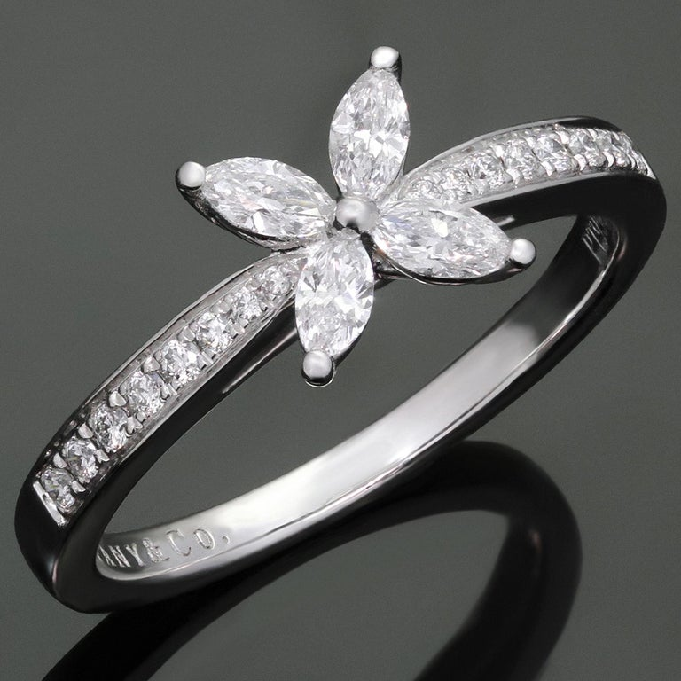 This iconic ring from Tiffany's exquisite Victoria collection is crafted in platinum and set with marquise-cut diamonds of an estimated 0.32 carats and brilliant-cut round diamonds of an estimated 0.12 carats. Made in United States circa 2010s. The