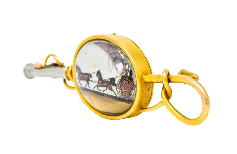 Brooch designed as a riding whip with a winding gold lash and a platinum hilt  Centering an oval rock crystal cabochon measuring approximately 21.5 x 16.5 mm; bezel set in a high polished gold surround  Rock crystal is transparent and backed by