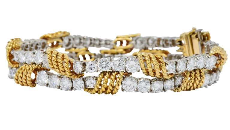 Featuring two rows of basket set, round brilliant cut diamonds weighing approximately 14.00 carats total, G/H color and VVS clarity  Diamonds set in platinum, graduating in size with wrapped twisted gold rope detail  Completed by a concealed clasp