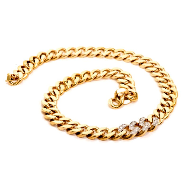 This vintage circa late 1970'S Tiffany & Co Heavy curb link chain necklace is crafted in solid 14K yellow gold. It weighs 101.2 grams . Composed of handcrafted interlocking flat curb links with an elegant pattern. Center three links are  covered by