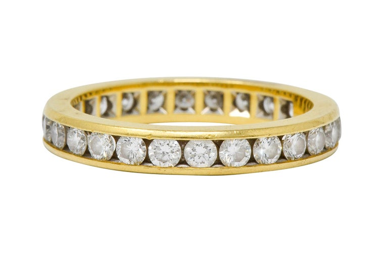 Eternity band ring channel set fully around by round brilliant cut diamonds  Weighing approximately 1.50 carats total with F/G color and VS clarity  Fully signed Tiffany & Co.  Stamped 750 for 18 karat gold  Circa: 1990s  Ring Size: 5 1/2 & not