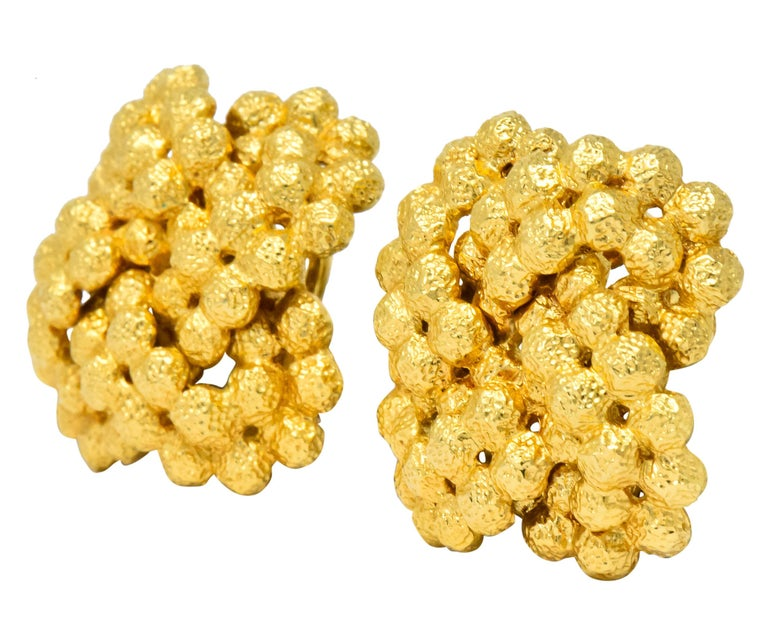 Gold, dimpled bead cluster earrings  Completed with omega hinged clip backs  Fully signed Tiffany & Co.  Stamped Italy and 18kt  Measures: 7/8 inch  Total weight: 15.4 grams  Textured. Lustrous. Bold.       Stock Number: We-2867