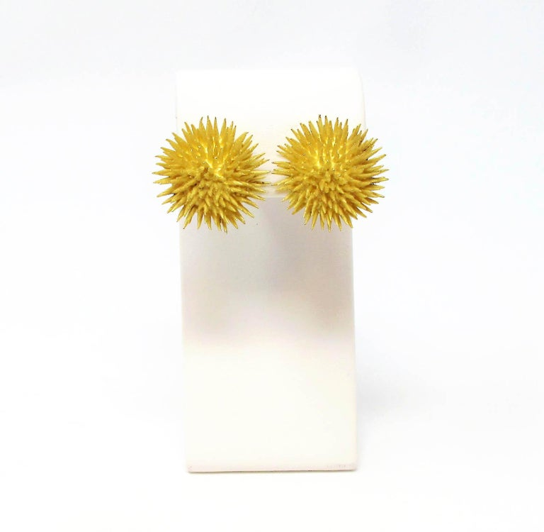 Incredible bold, vintage clip-on earrings from esteemed jeweler, Tiffany & Co. These chic, life-like sea urchin earrings are made of solid 18 karat yellow gold in a satin finish. The tiny spikes are slightly tapered with sharp, pointed ends while