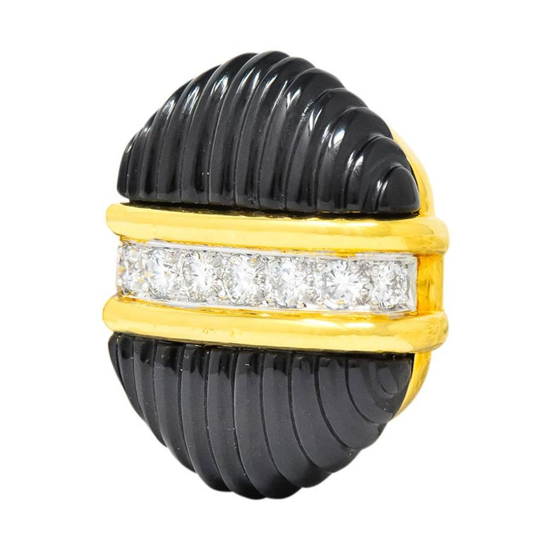 Each earring centering a horizontal row of round brilliant cut diamonds, bead set in platinum, weighing approximately 1.92 carats total, G/H in color and VS clarity  With two highly polished half circles of deeply carved onyx  Completed by hinged