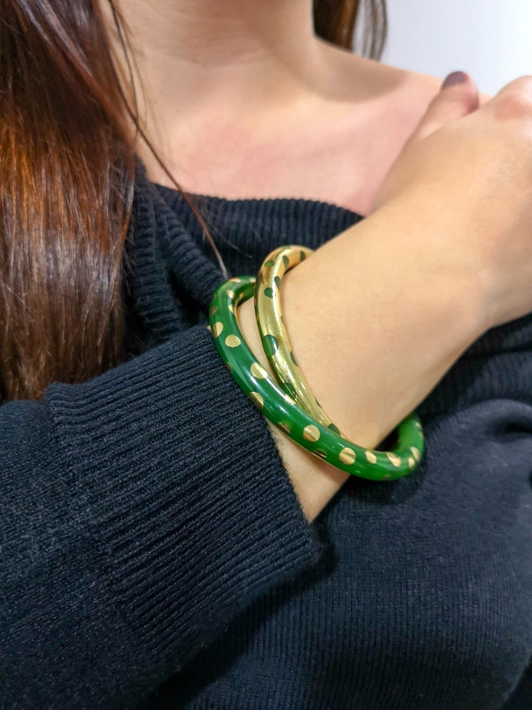 From the famed house of Tiffany & Co. we are delighted to present this astonishing, stylish and unusual double interlinked double bracelet from the late 1960s / early 1970s. The first bracelet of 18-carat yellow gold, inlaid with different sized