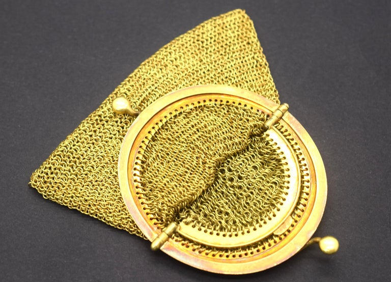 Gorgeous Tiffany & Co. vintage mesh purse crafted in 18k yellow gold. This unique item is truly one of a kind. The purse is crafted out of solid 18k yellow gold. The purse has a hinge opening with a dual separated compartment inside. The condition