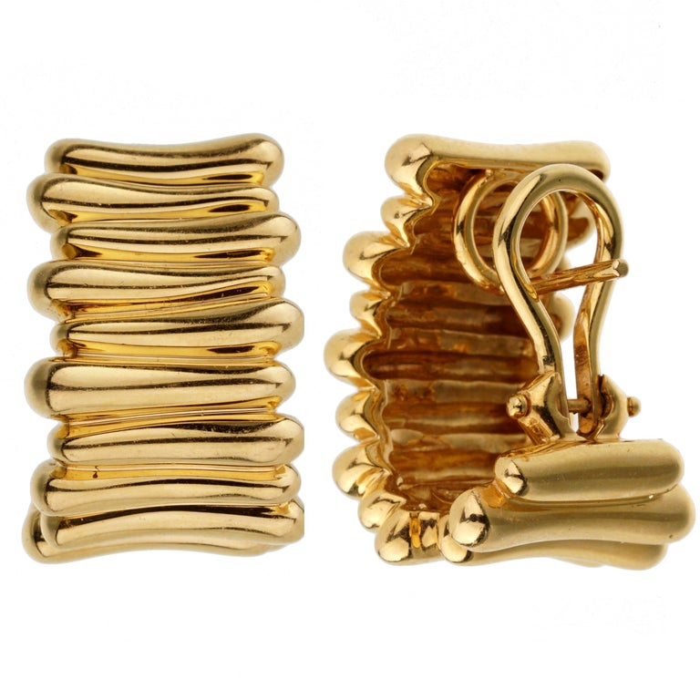 An intriguing set of Tiffany & Co earrings showcasing an overlapping yellow gold design. The earrings have a length of .78