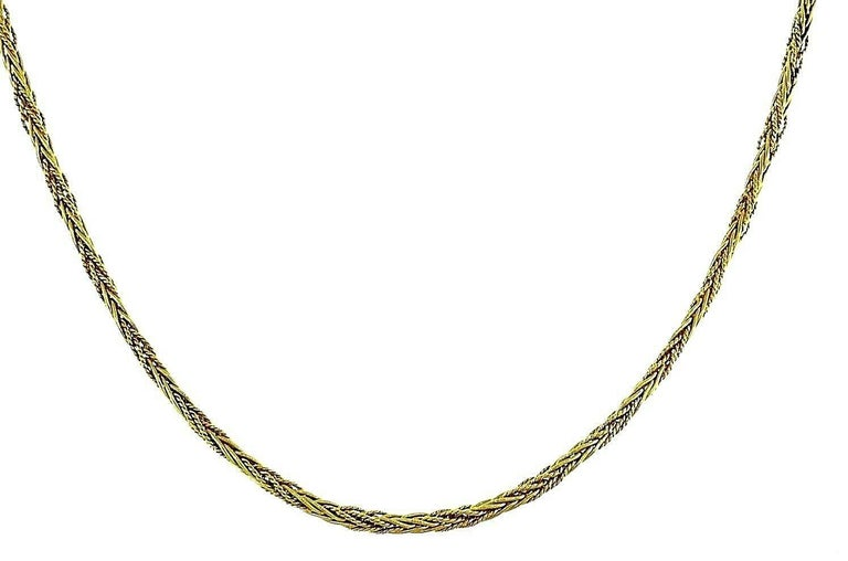Gorgeous long 18k yellow gold chain necklace by Tiffany & Co. Vintage (c.1970s) wheat link chain, featuring textured and polished gold threads.  Stamped with Tiffany & Co. maker's mark, a hallmark for 18k gold and a country of origin
