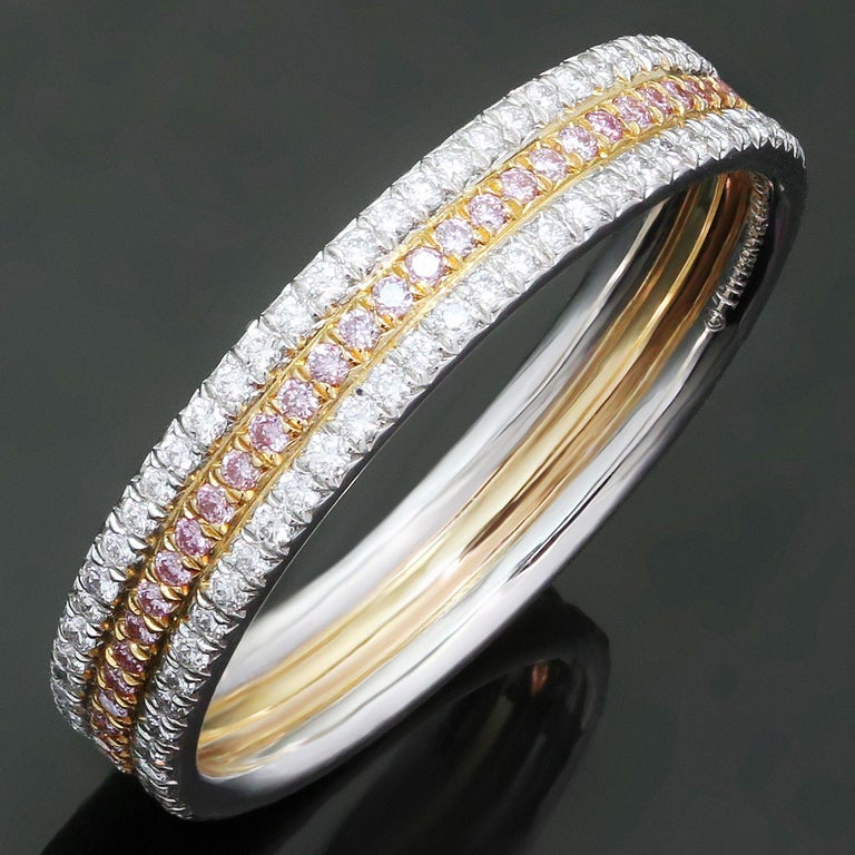 This stunning three-row band from Tiffany & Co. features white & pink F-G VVS2-VS1 brilliant-cut round diamonds of an estimated 0.55 carats, with pink diamonds set in 18k rose gold and white diamonds set in 950 paltinum. Made in United States circa