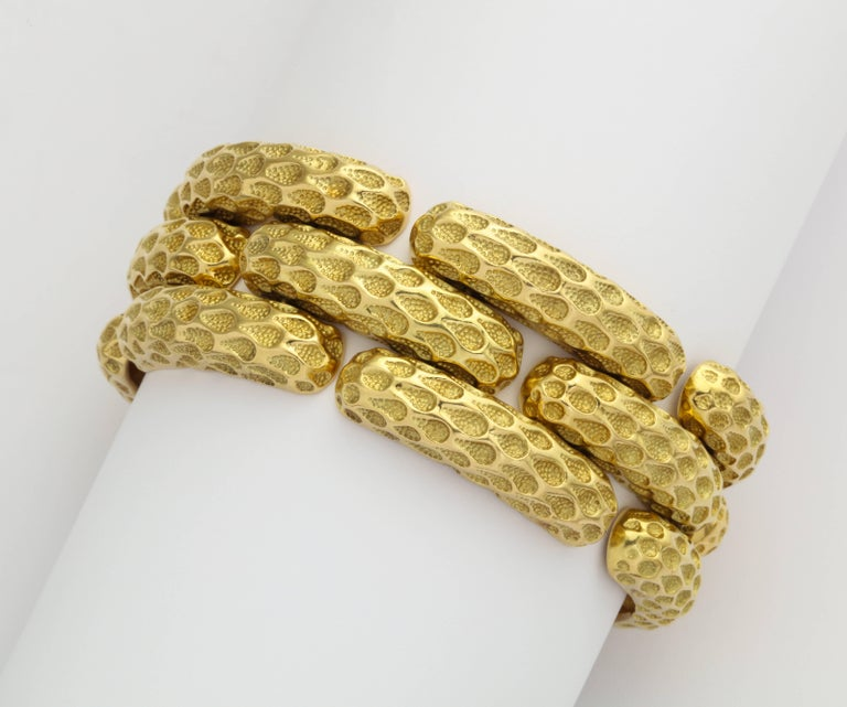 A chic and substantial 1970s Tiffany bracelet in 18K gold with a polished surface pattern replicating net, contrasted by hand applied texture deep in the recesses, all nicely articulated to be comfortably worn day into night. Marked Tiffany - Italy
