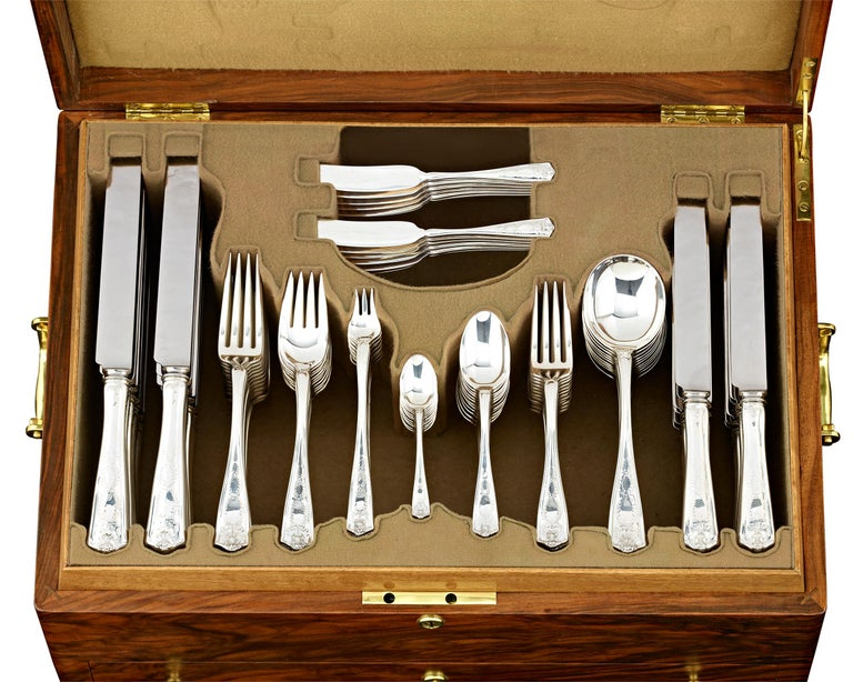 This magnificent silver flatware service for 12 by Tiffany & Co. displays the enchanting Winthrop pattern. Introduced by Tiffany & Co. in 1909, Winthrop is beautifully styled and remains one of the company's most celebrated motifs. Incorporating
