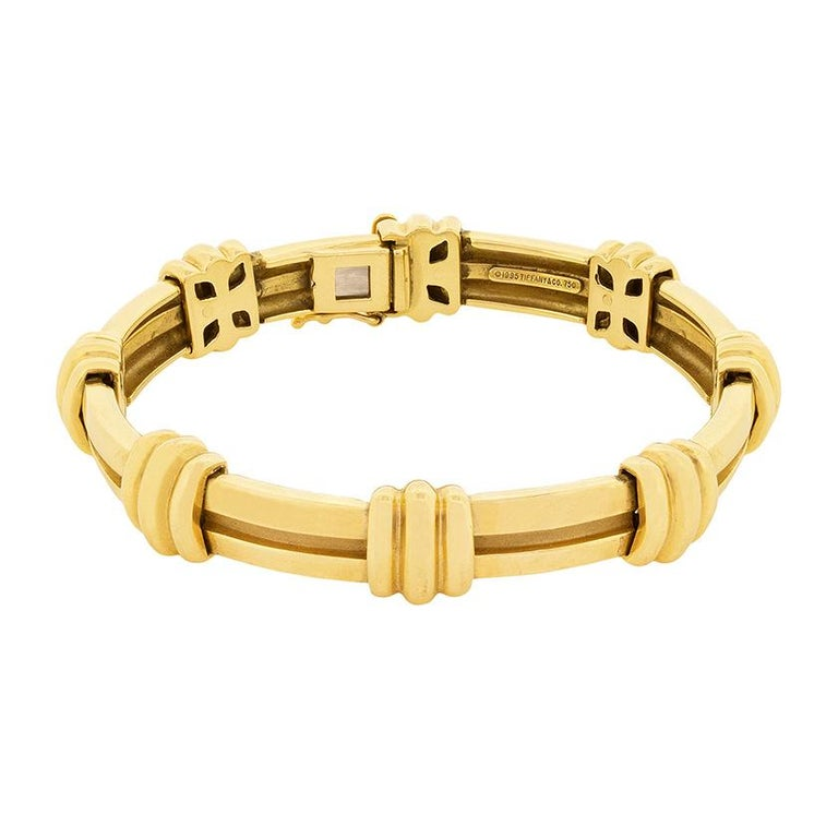 This Tiffany & Co bracelet is from the Atlas collection. It weighs 40.6 grams and is made from 18 carat yellow gold. It has the original Tiffany & Co makers mark and also has a matching necklace and earrings available.     Designer: Tiffany &