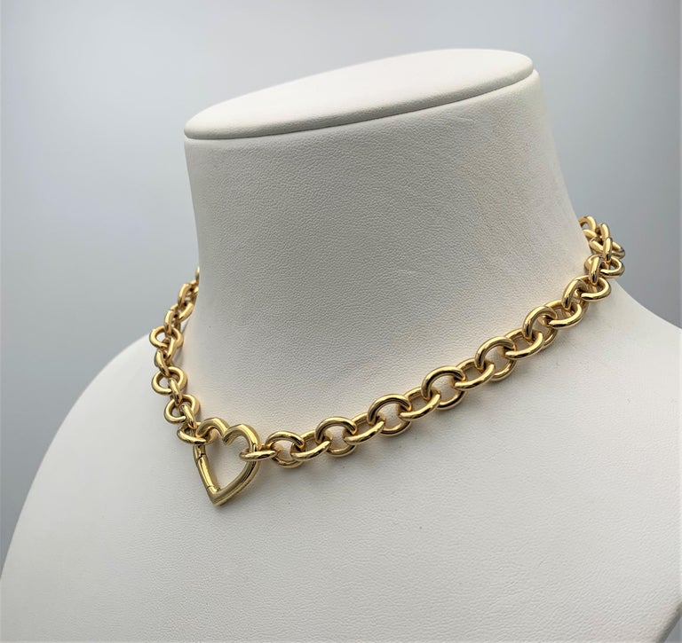 Authentic Tiffany & Co. necklace crafted in 18 karat yellow gold features an open heart pendant clasp. Signed Tiffany & Co., 750. The necklace measures 15 3/4 inches in length. Presented with the original box, no papers. CIRCA 2000s.