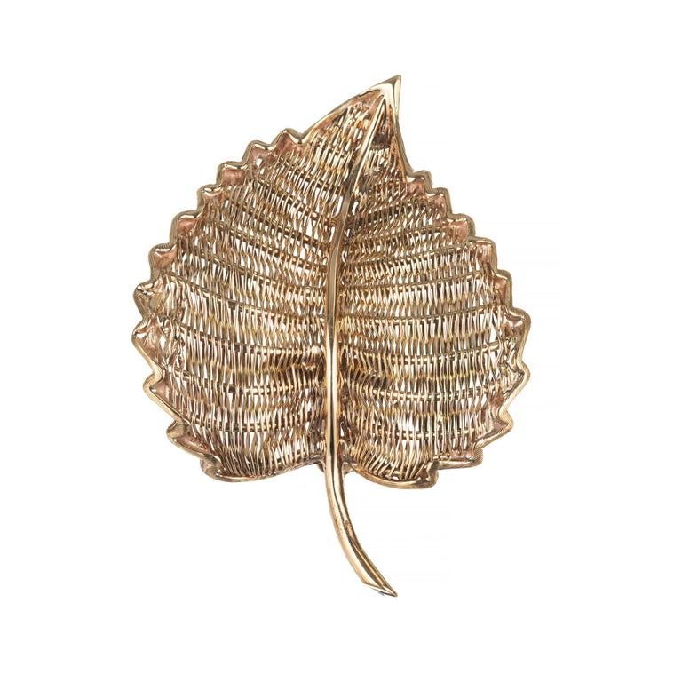 Tiffany & Co. yellow gold woven wire leaf brooch. Woven front and back to create the leaf design. Signed Tiffany & Co Italy, 18k. Circa 1950-1960.  18k Yellow Gold Stamped 18k Tiffany + Co Italy 9.9 grams 1 7/8 x 1 3/8 inches.