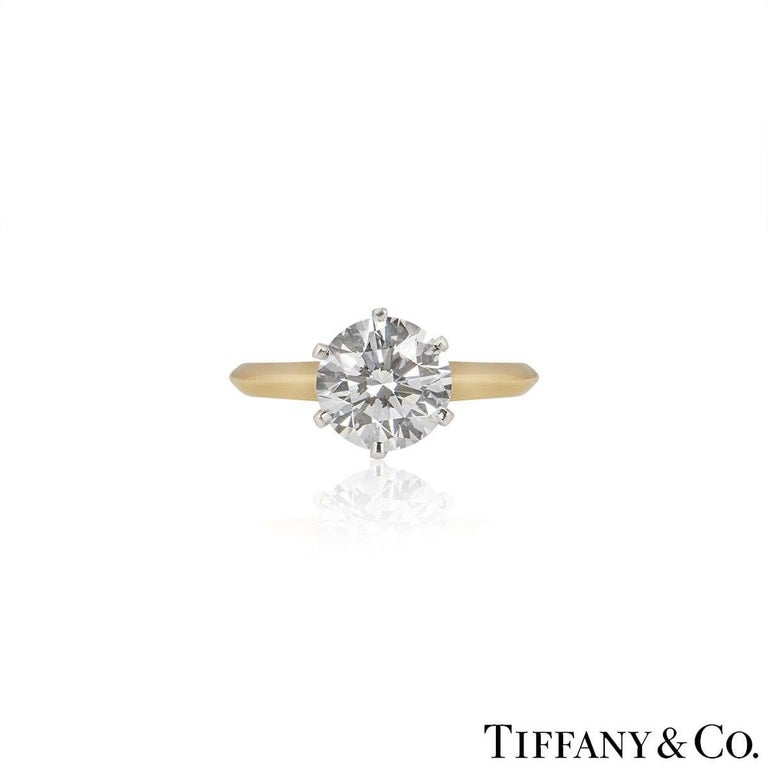 A beautiful 18k yellow gold diamond ring by Tiffany & Co. from The Setting collection. The ring comprises of a round brilliant cut diamond in a 6 claw setting with a weight of 2.05ct, D colour and VVS2 clarity. The ring is currently a size UK L / EU