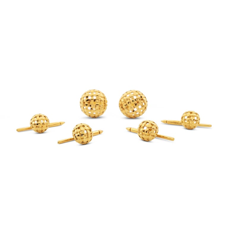 Authentic Tiffany & Co. yellow gold cufflinks and studs dress set, each designed as a domed openwork basket weave. Cufflink tops measure 18mm in diameter. Dress studs measure 11mm in diameter. Signed T&Co., 750, 1996. The set is not presented with