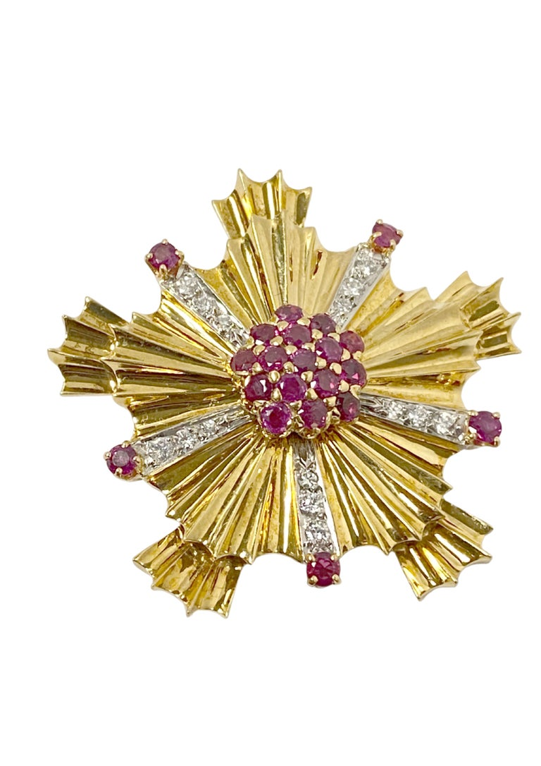 Circa 1940s Tiffany & Company Retro Patriotic Clip Brooch Group, each 14k Yellow Gold Starburst form Brooch measures 1 5/8 inches in diameter, set with fine color Rubies and Sapphires and further set with Diamonds totaling 2 Carats for the grouping.