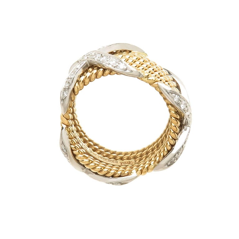 Circa 2000 Jean Schlumberger for Tiffany & Company, 18K Yellow and White Gold 6 row Rope, classic X Ring, set with Round Brilliant cut Diamonds totaling approximately 1 carat and Grading as F-G in color and VS in Clarity. The ring measures 7/16 Inch