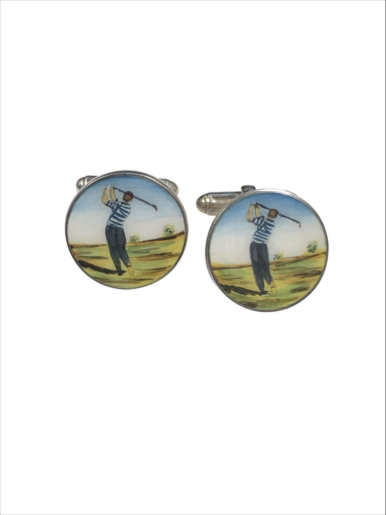 Circa 2005 Tiffany & company Sterling Silver and Enamel Golf Theme Cufflinks, the tops measure 3/4 inch in diameter and feature a hand painted hard fired Enamel scene of a Golfer. Having toggle backs for easy on and off. Excellent near unworn